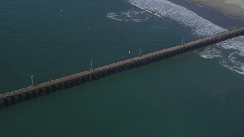 5K stock footage aerial video flyby beach to reveal the pier at Avila Beach, California Aerial Stock Footage | DFKSF02_049