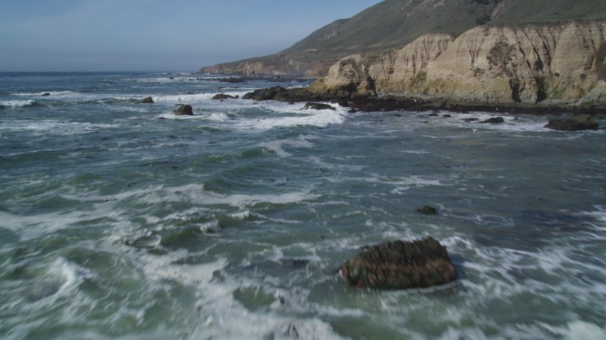 5K stock footage aerial video of approaching coastal cliffs, rock formations, Avila Beach, California Aerial Stock Footage | DFKSF02_066