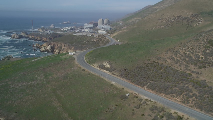 5K stock footage aerial video fly low beside the coast, reveal Diablo Canyon Power Plant, Avila Beach, California Aerial Stock Footage | DFKSF02_070
