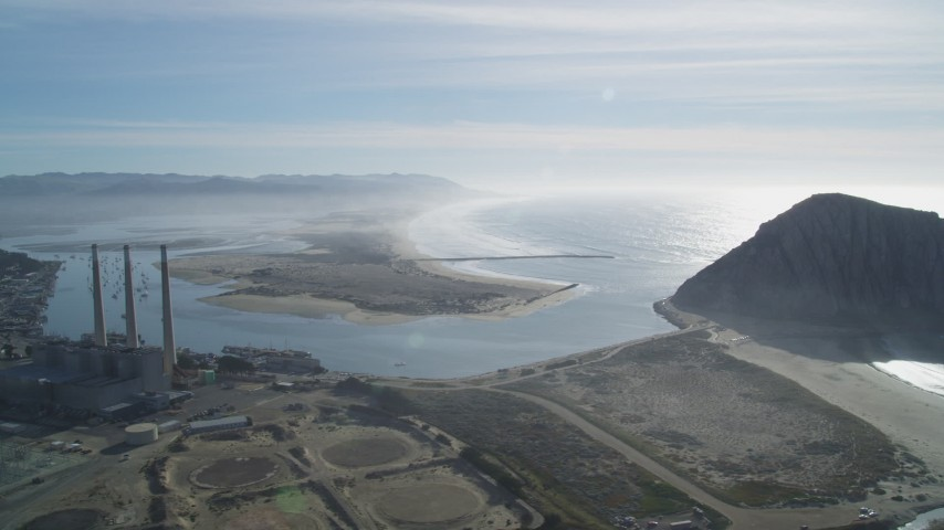 5K stock footage aerial video of flying by Dynegy Power Plant, Morro Rock, coast, harbor in Morro Bay, California Aerial Stock Footage   DFKSF03_012