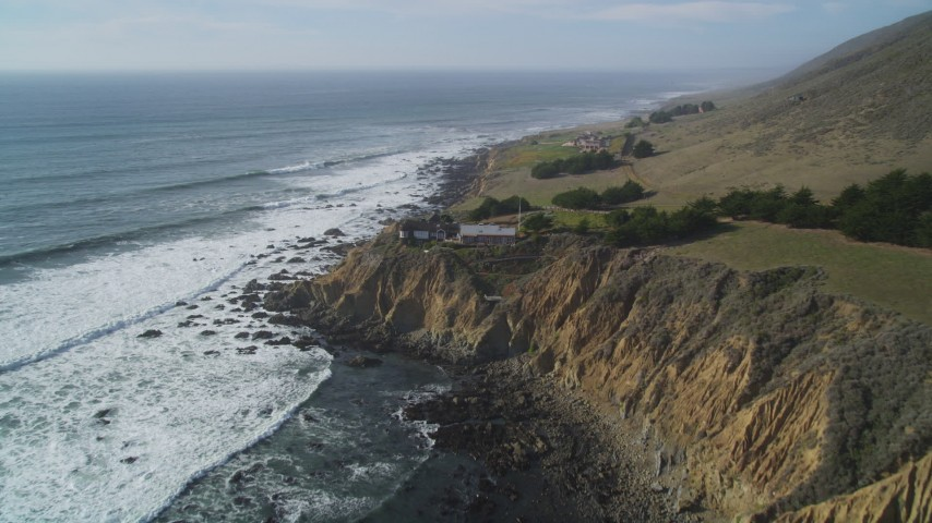 5K stock footage aerial video approach house on a cliff overlooking Pacific Ocean, Cambria, California Aerial Stock Footage | DFKSF03_035