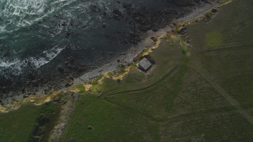 5K stock footage aerial video of a bird's eye view of coastal cliffs and jagged coastline, Cambria, California Aerial Stock Footage | DFKSF03_040