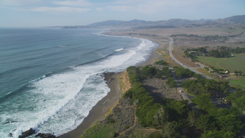 5K stock footage aerial video of tilting from the ocean to follow coastline near Highway 1, Cambria, California Aerial Stock Footage | DFKSF03_045
