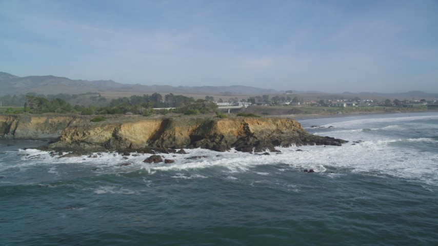 5K stock footage aerial video of flying away from jagged coastal cliffs, San Simeon, California Aerial Stock Footage | DFKSF03_049