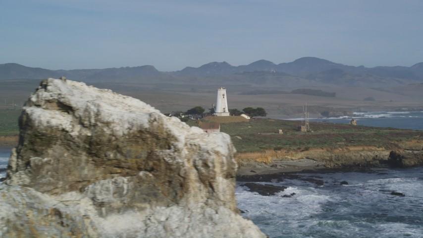 5K stock footage aerial video of passing by Point Piedras Blancas lighthouse, San Simeon, California Aerial Stock Footage | DFKSF03_074