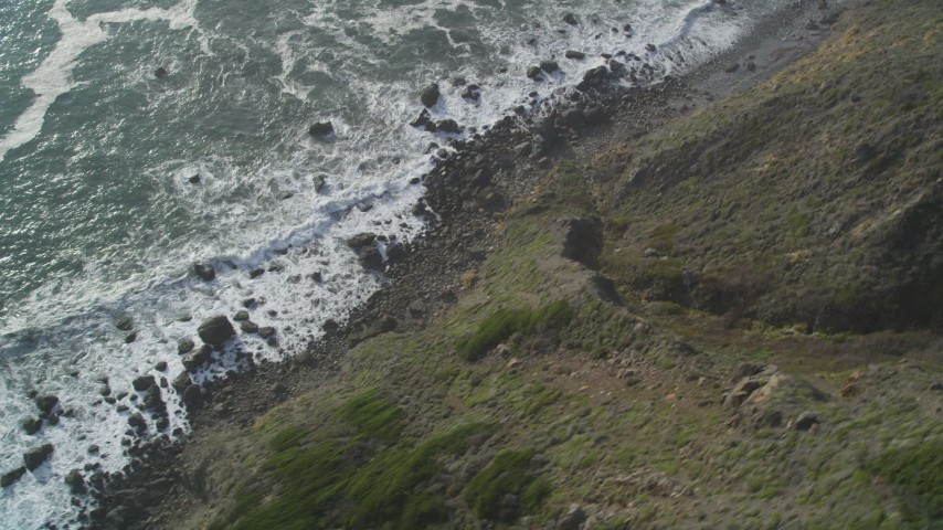 5K stock footage aerial video of a bird's eye view of waves below coastal cliffs, Big Sur, California Aerial Stock Footage | DFKSF03_084