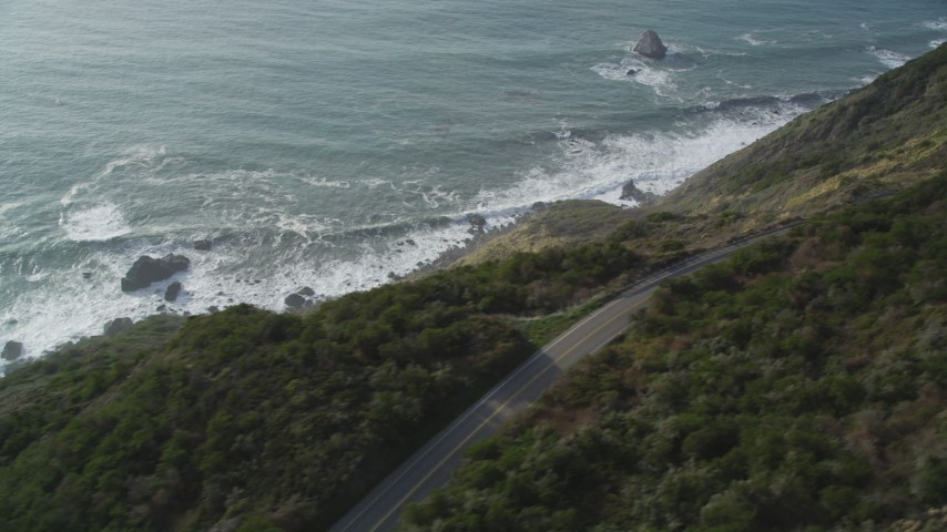 5K aerial video of flying by Highway 1 coastal road above cliffs, Big Sur, California Aerial Stock Footage | DFKSF03_086