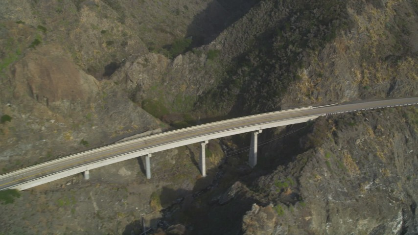 5K aerial video of flying by a small bridge on Highway 1, above coastal cliffs, Big Sur, California Aerial Stock Footage | DFKSF03_089