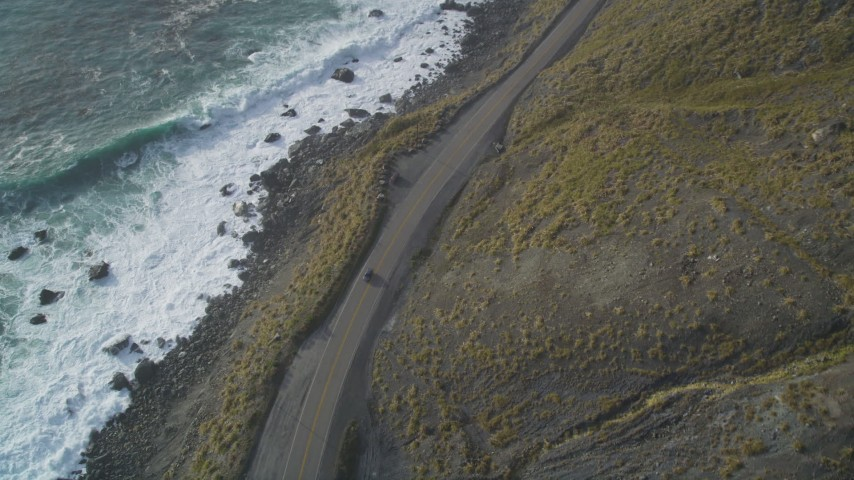 5K aerial video of tracking a car traveling on Highway 1 along the coast, Big Sur, California Aerial Stock Footage | DFKSF03_091