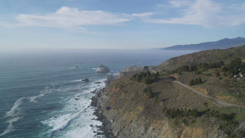 5K aerial video of approaching a large rock formation off the coast, Big Sur, California Aerial Stock Footage DFKSF03_092