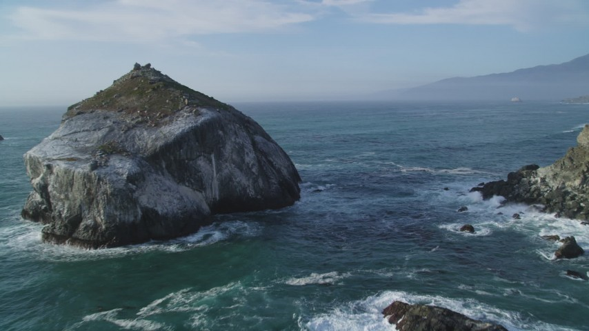 5K stock footage aerial video approach and flyby a large rock formation off the coast, Big Sur, California Aerial Stock Footage | DFKSF03_094