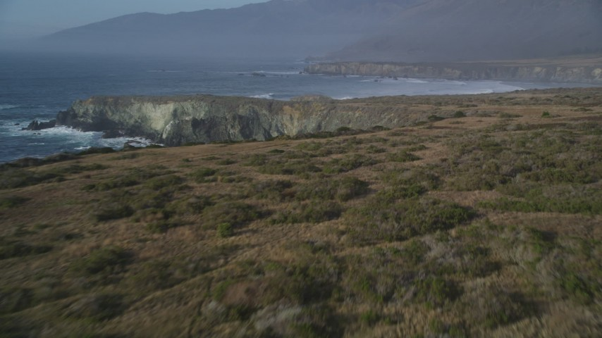 5K aerial video approach and fly over coastal cliffs, Big Sur, California Aerial Stock Footage | DFKSF03_100