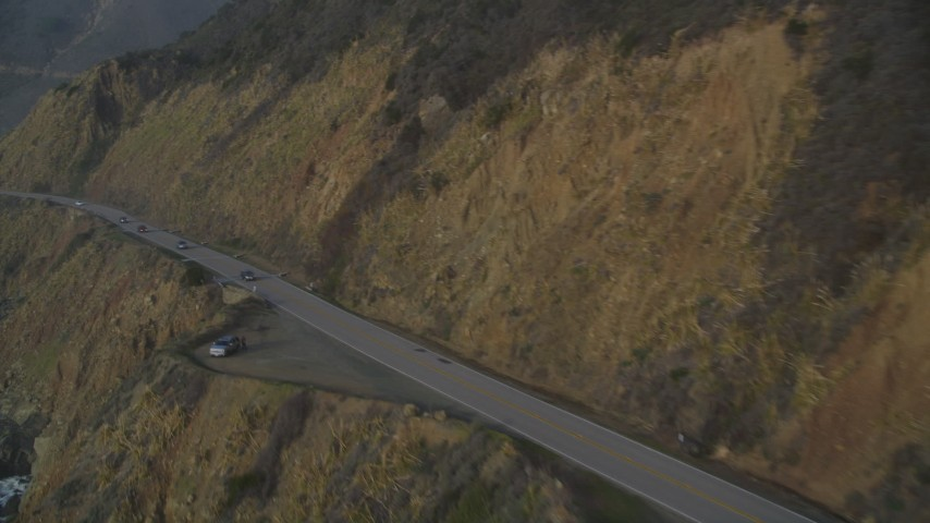 5K stock footage aerial video of flying over coastal cliffs, revealing Highway 1 coastal road, Big Sur, California Aerial Stock Footage | DFKSF03_108