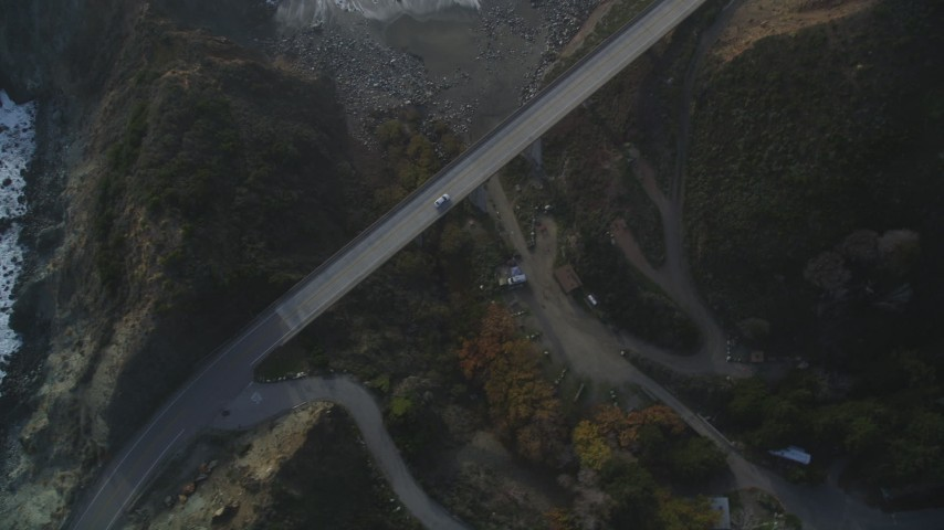 5K aerial video of tracking a white car on Highway 1 coastal road, Big Sur, California Aerial Stock Footage | DFKSF03_113