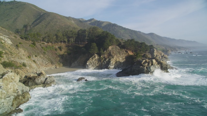 5K aerial video of approaching McWay Falls and coastal cliffs, Big Sur, California Aerial Stock Footage DFKSF03_116