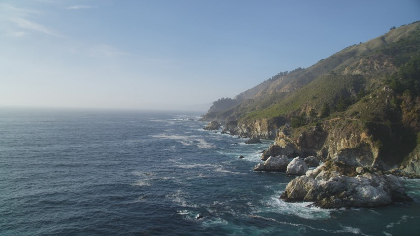 5K aerial video of flying over the ocean and passing coastal cliffs, Big Sur, California Aerial Stock Footage | DFKSF03_119