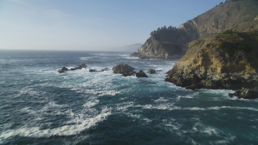 5K stock footage aerial video of flying by coastal cliffs and over rock formations, Big Sur, California Aerial Stock Footage | DFKSF03_120