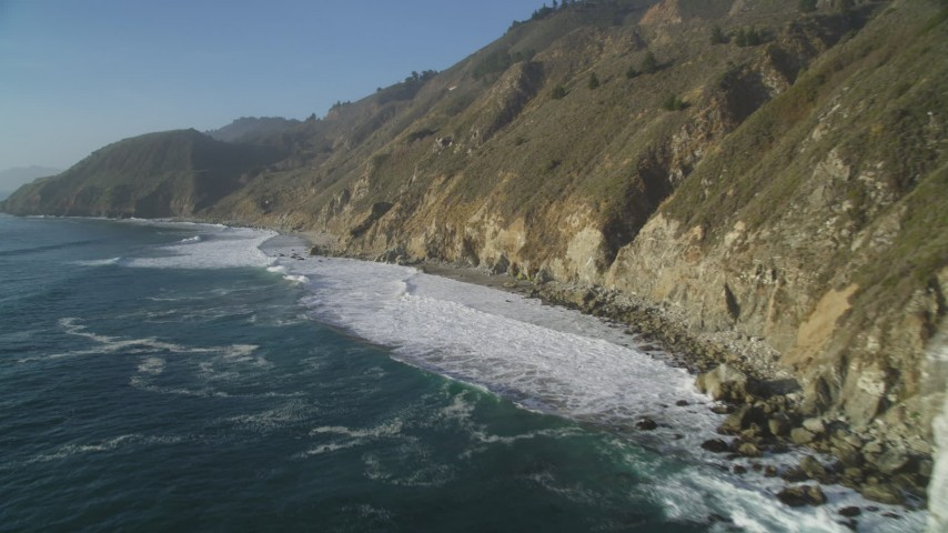 5K aerial video of flying low around coastal cliffs, Big Sur, California Aerial Stock Footage | DFKSF03_126