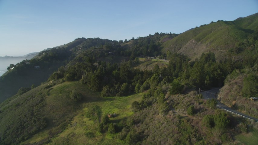 5K aerial video of flying over hills, approaching Highway 1, Big Sur, California Aerial Stock Footage | DFKSF03_128