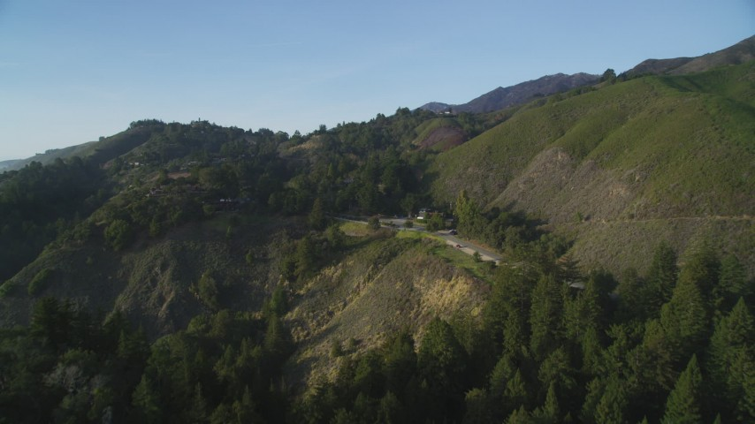 5K aerial video of approaching hills beside Highway 1 and roadside restaurant, Big Sur, California Aerial Stock Footage | DFKSF03_129