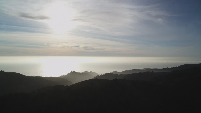 5K stock footage aerial video of a view of the Pacific Ocean, seen from the hills, Big Sur, California Aerial Stock Footage | DFKSF03_132