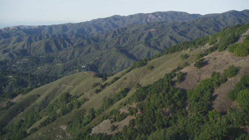 5K stock footage aerial video of flying over green mountains in Los Padres National Forest, California Aerial Stock Footage | DFKSF03_136