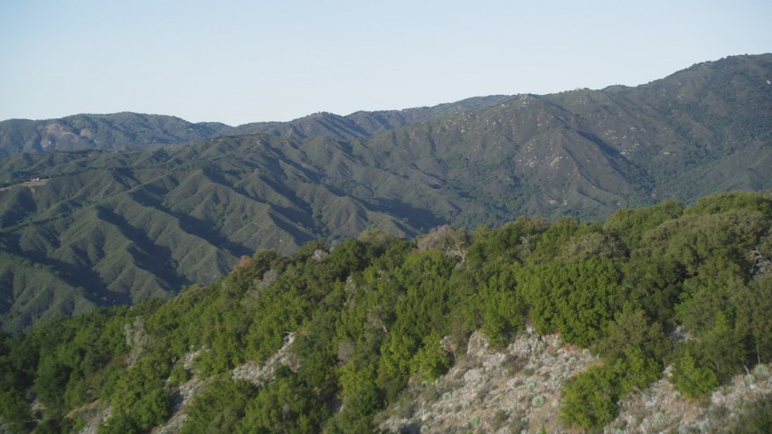 5K stock footage aerial video pan across green ridges in a mountain landscape, Los Padres National Forest, California Aerial Stock Footage | DFKSF03_137