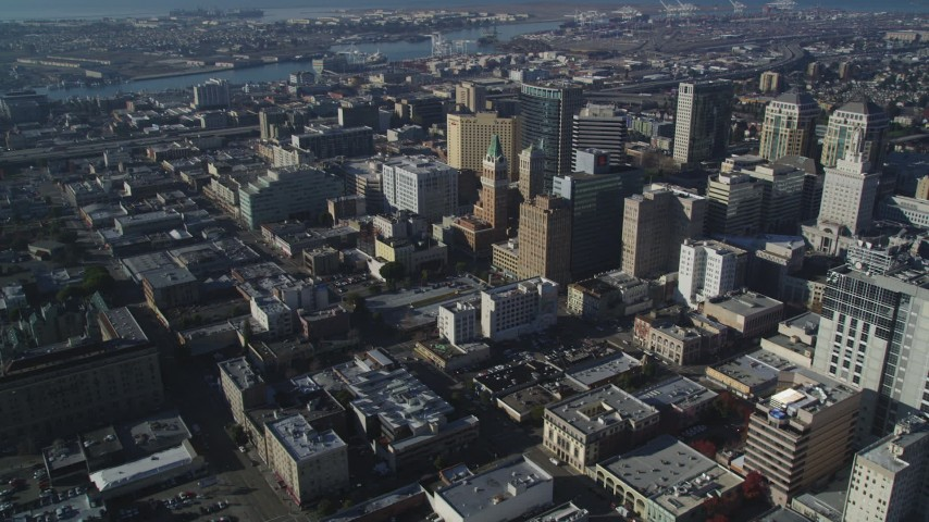 5K stock footage aerial video of flying by city buildings around Tribune Tower in Downtown Oakland, California Aerial Stock Footage | DFKSF05_004