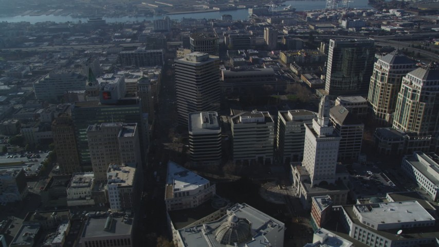 5K stock footage aerial video of passing city hall and surrounding city buildings, Downtown Oakland, California Aerial Stock Footage | DFKSF05_005