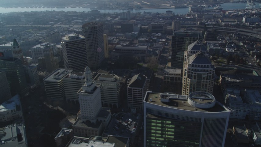 5K stock footage aerial video flyby city hall, federal building and high-rises in Downtown Oakland, California Aerial Stock Footage | DFKSF05_006