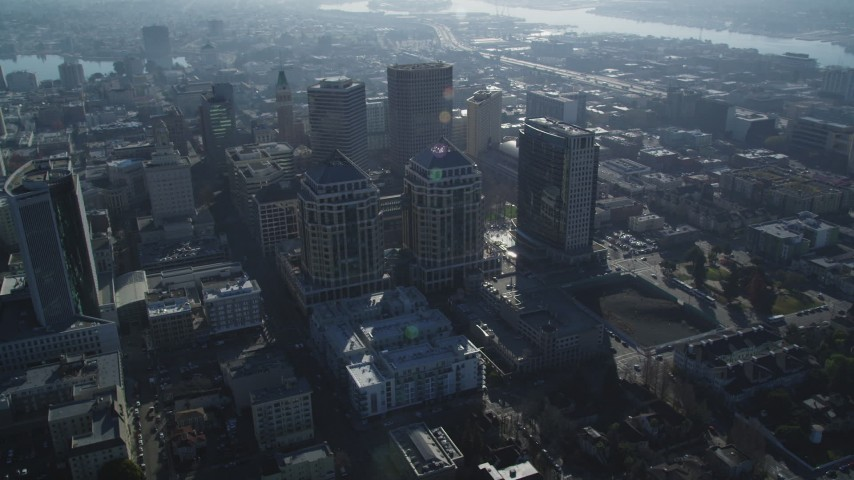 5K stock footage aerial video fly away from city hall, federal building and city buildings, Downtown Oakland, California Aerial Stock Footage | DFKSF05_007
