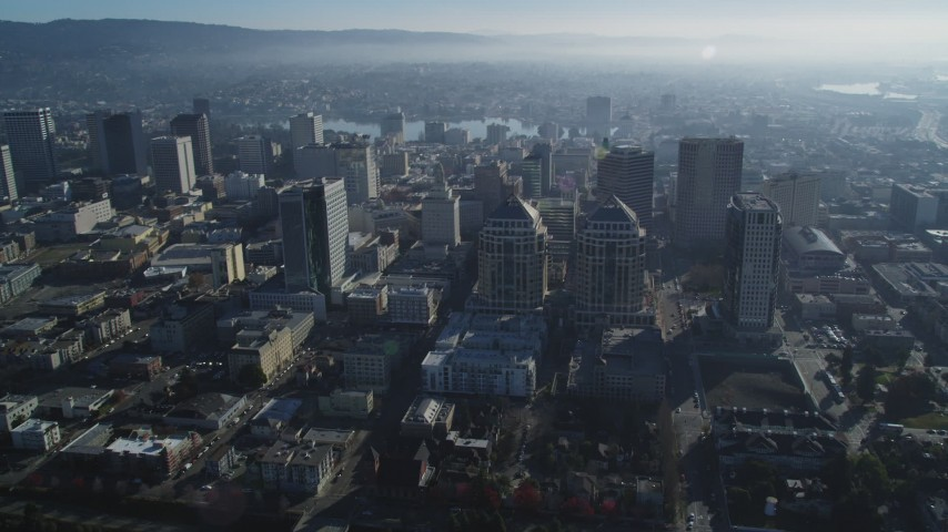 5K stock footage aerial video reverse view of federal building and city buildings, Downtown Oakland, California Aerial Stock Footage | DFKSF05_008
