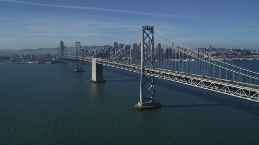 5K stock footage aerial video tilt from the bay to reveal the Bay Bridge, Downtown San Francisco skyline, California Aerial Stock Footage | DFKSF05_011