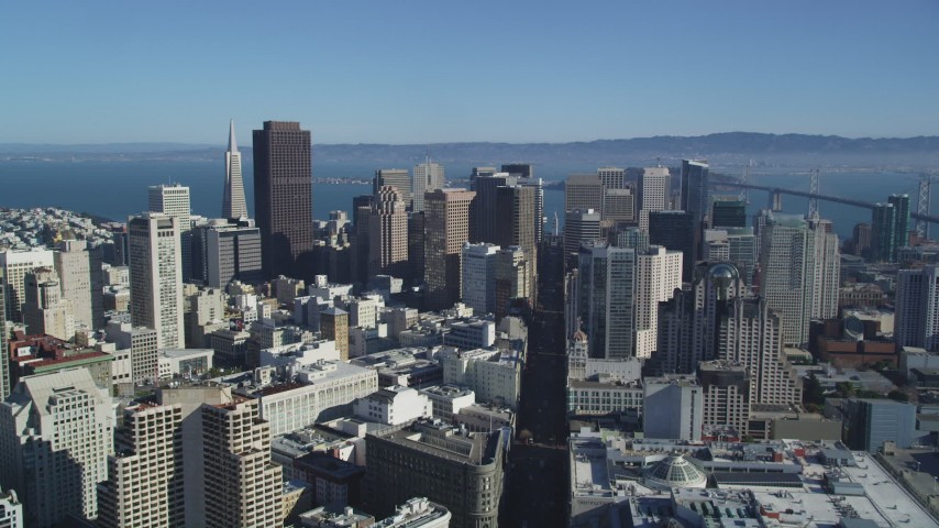 5K stock footage aerial video of flying over Market Street to approach skyscrapers, Downtown San Francisco, California Aerial Stock Footage | DFKSF05_018