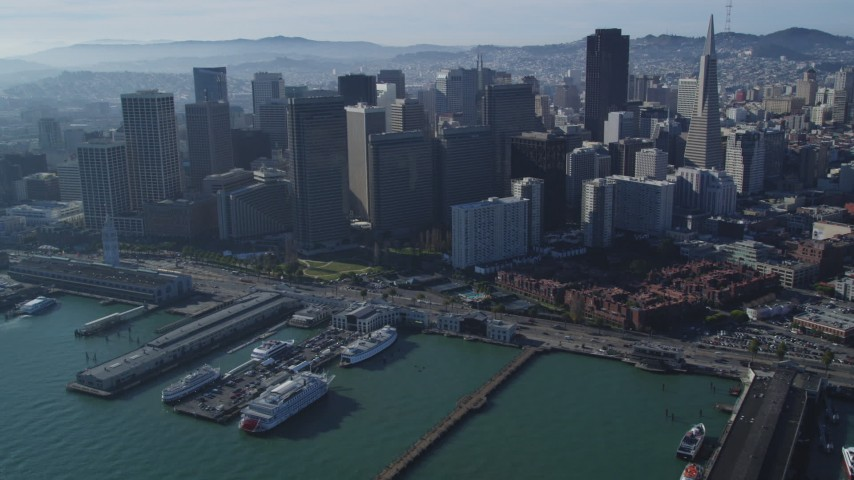 5K stock footage aerial video of the Ferry Building and skyscrapers in Downtown San Francisco, California Aerial Stock Footage | DFKSF05_020