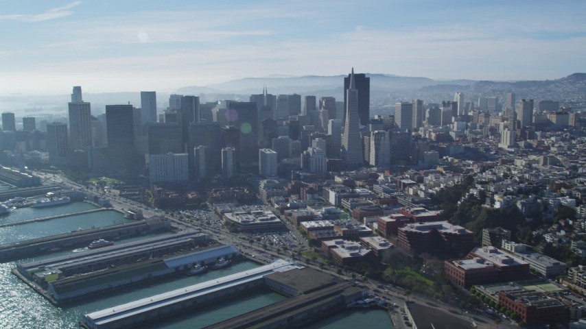 5K stock footage aerial video of reverse view of skyscrapers, reveal North Beach and Coit Tower, Downtown San Francisco, California Aerial Stock Footage | DFKSF05_022
