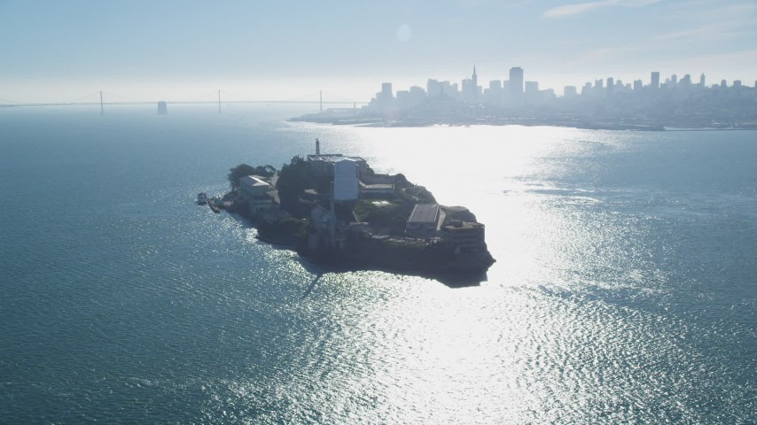Flying by Alcatraz, Downtown Skyline, Bay Bridge, San Francisco, California Aerial Stock Footage | DFKSF05_028