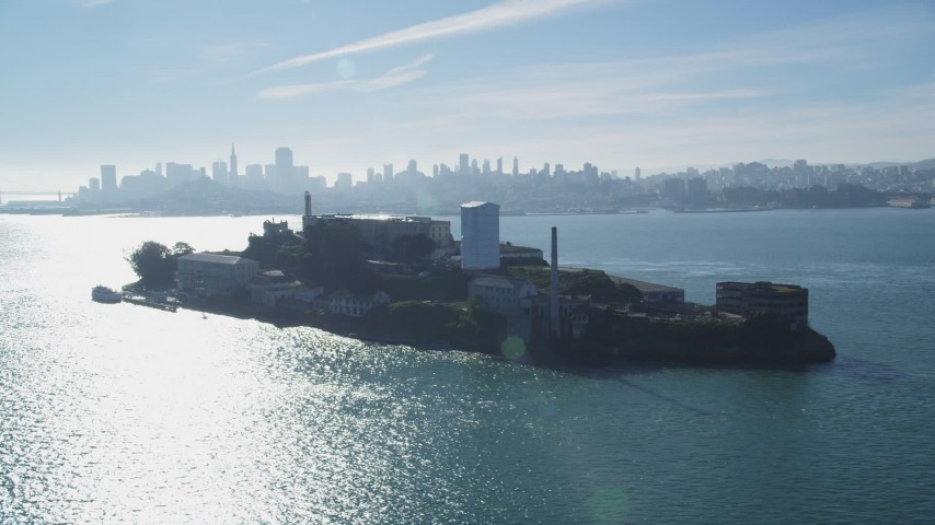5K stock footage aerial video of flying by the historic landmark Alcatraz with views of city skyline, San Francisco, California Aerial Stock Footage | DFKSF05_029