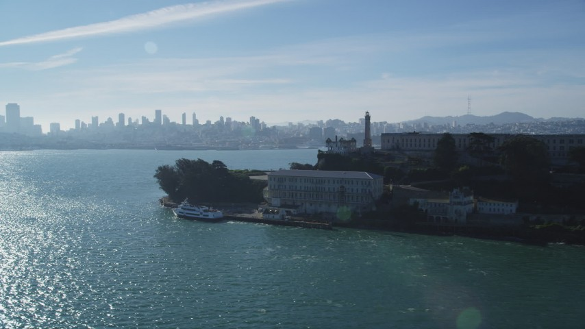 5K stock footage aerial video flyby iconic Alcatraz, pan to skyline of Downtown San Francisco, California Aerial Stock Footage | DFKSF05_030
