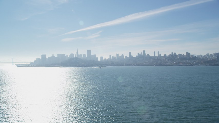 5K stock footage aerial video fly over the bay to approach the city skyline of Downtown San Francisco, California Aerial Stock Footage   DFKSF05_031