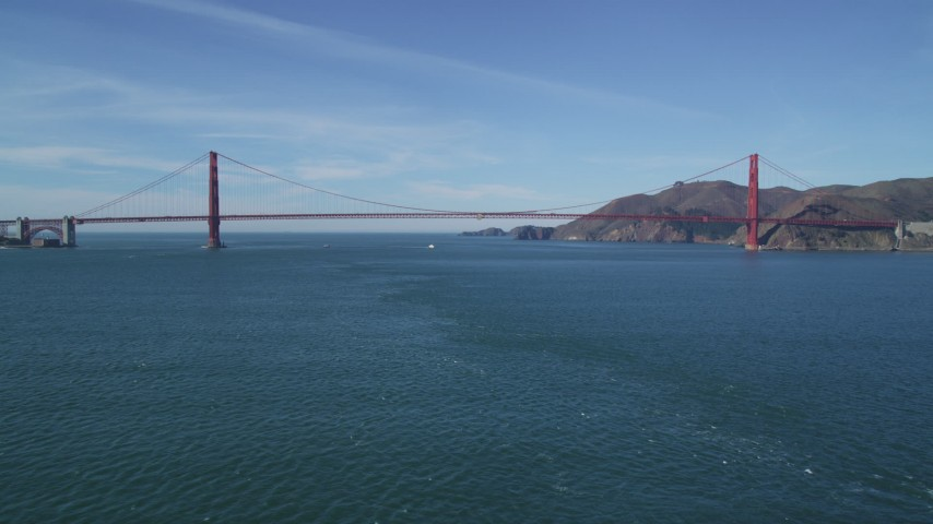 5K aerial video fly over the bay to approach the famous Golden Gate Bridge, San Francisco, California Aerial Stock Footage | DFKSF05_033