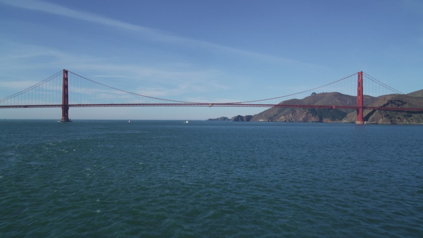 5K aerial video fly low over the bay to approach the iconic Golden Gate Bridge, San Francisco, California Aerial Stock Footage | DFKSF05_034
