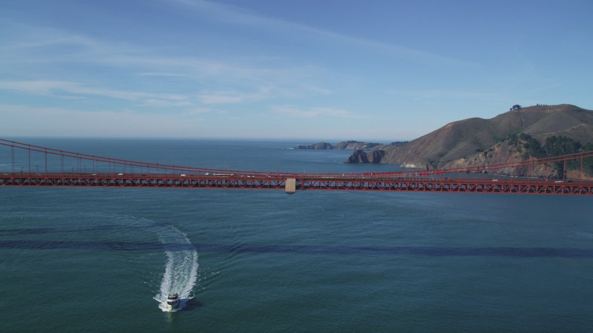 5K stock footage aerial video of flying over the iconic Golden Gate Bridge toward the Marin Headlands, San Francisco, California Aerial Stock Footage | DFKSF05_036