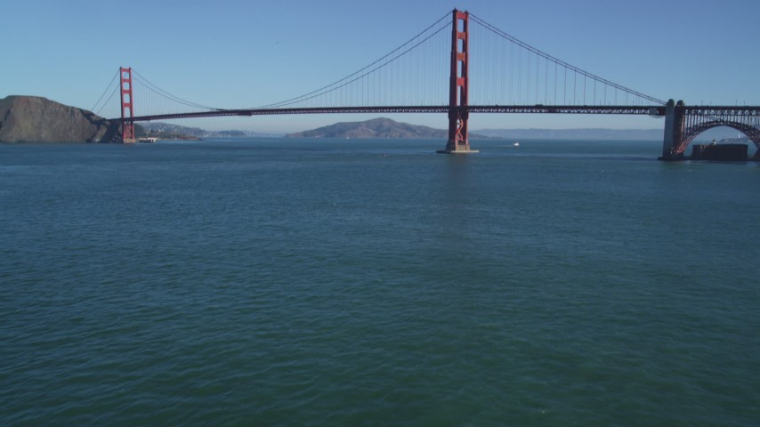 5K aerial video tilt from the bay to reveal the famous Golden Gate Bridge, San Francisco, California Aerial Stock Footage | DFKSF05_038