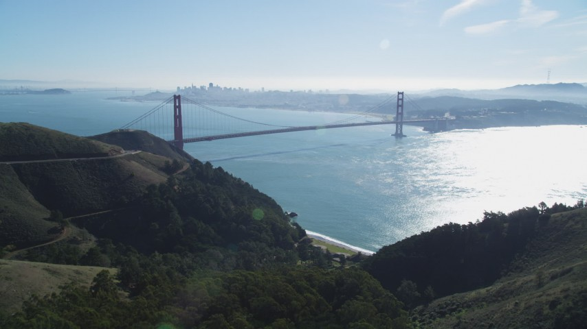 5K aerial video fly over Marin Hills to reveal Golden Gate Bridge, an iconic landmark, San Francisco, California Aerial Stock Footage | DFKSF05_050