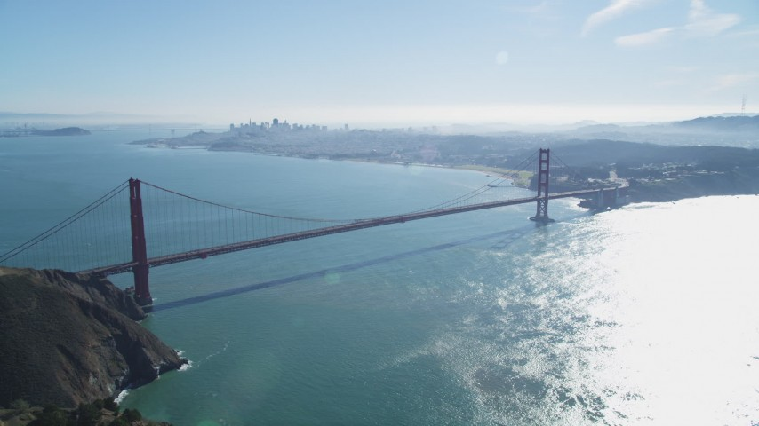 5K stock footage aerial video approach the famous Golden Gate Bridge and city skyline, Downtown San Francisco, California Aerial Stock Footage | DFKSF05_052