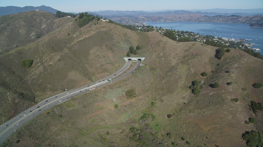 5K stock footage aerial video of approaching Robin Williams Tunnel (Waldo Tunnel), Marin Hills, Sausalito, California Aerial Stock Footage | DFKSF05_053