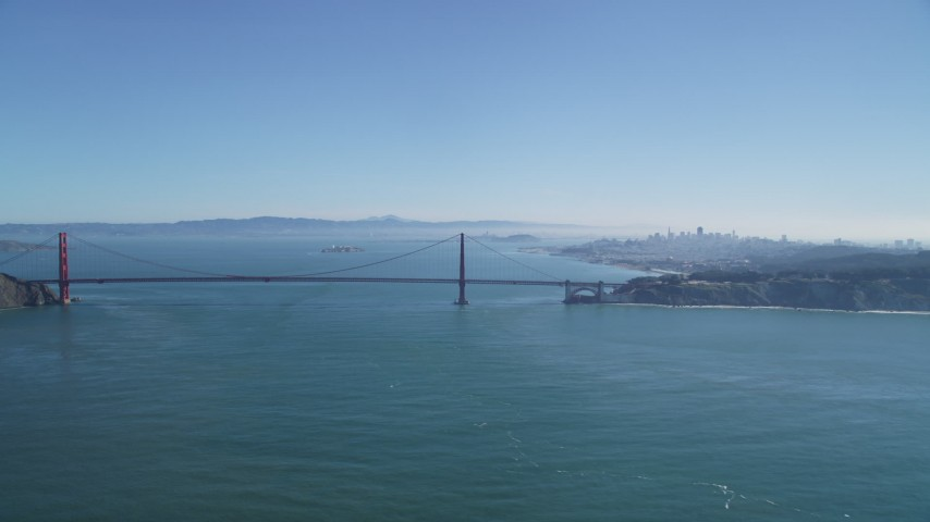 5K stock footage aerial video of the iconic Golden Gate Bridge, city skyline in the background, San Francisco, California Aerial Stock Footage | DFKSF05_056