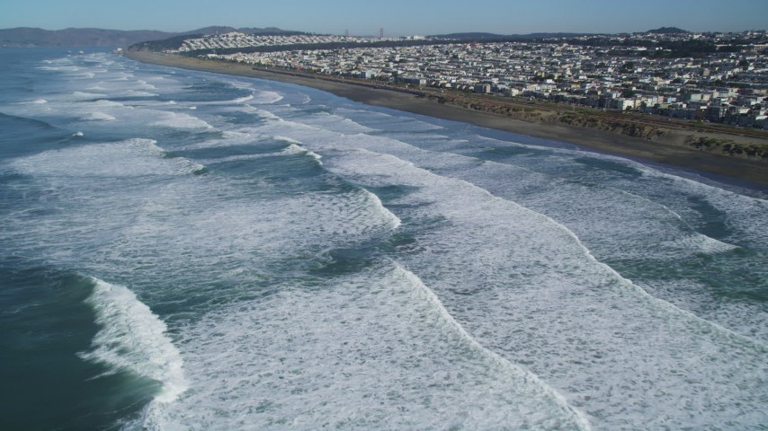 5K stock footage aerial video fly over waves rolling into the Outer Sunset District community, San Francisco, California Aerial Stock Footage | DFKSF05_061