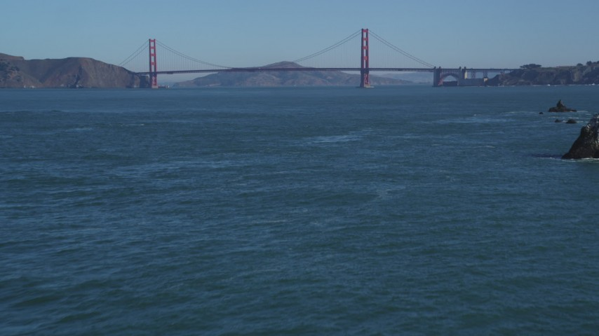 5K aerial video of tilting from the ocean to reveal the famous Golden Gate Bridge, San Francisco, California Aerial Stock Footage | DFKSF05_062